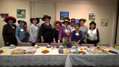 The Lacey Friends at their Mad Hatter Tea Table for Lacey's 40th Anniversary