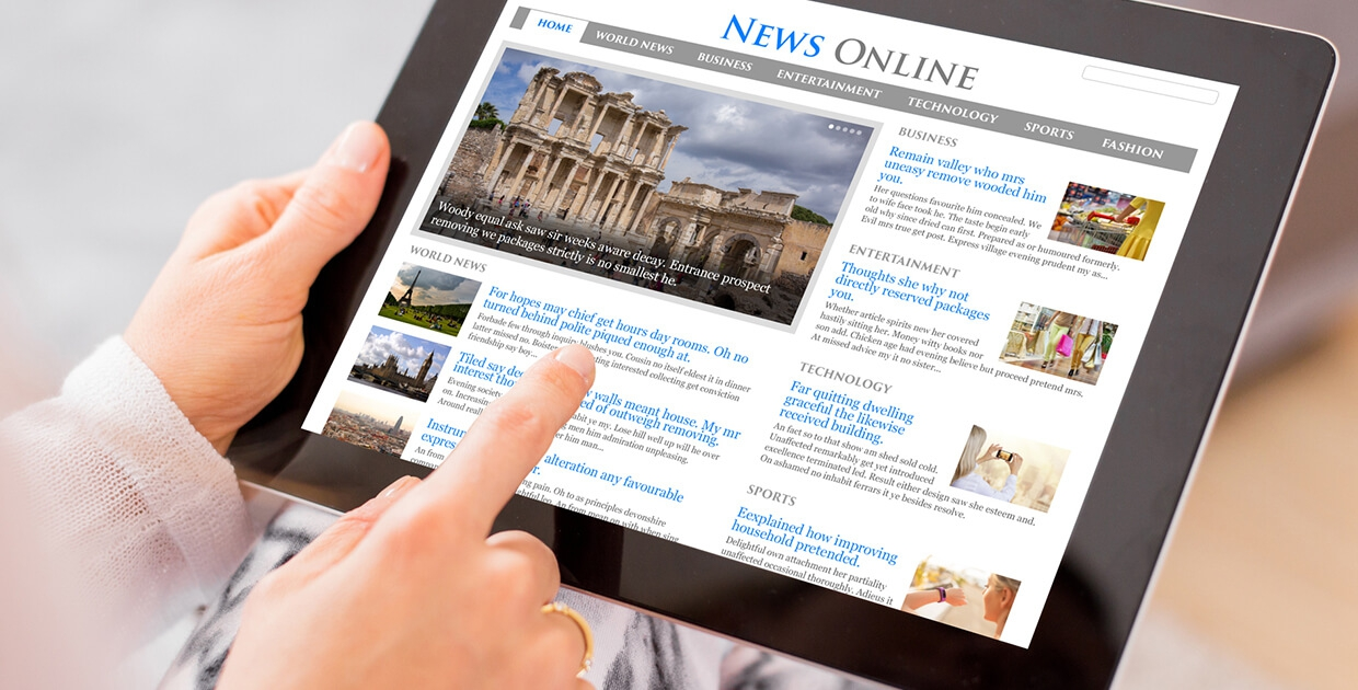 Tablet displaying online newspaper article.