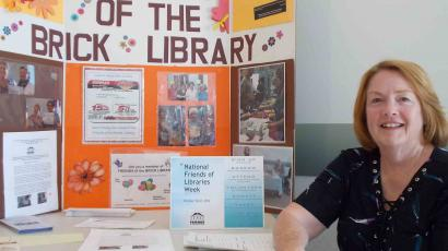 Sue MacDougall hosts the membership table for National Friends of Libraries Week